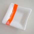 White with orange square dish