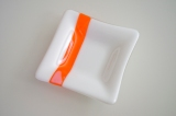 White with orange square dish