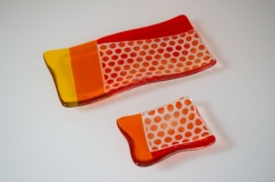 Set of orange polka dot plates