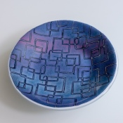 "10"" ""batiky"" bowl in purples and pinks on white sheet glass"