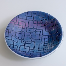 """10"""" """"batiky"""" bowl in purples and pinks on white sheet glass"""