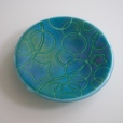 "6"" ""batiky"" dish in a blend of greens, blues, purples on robin's egg sheet glass"